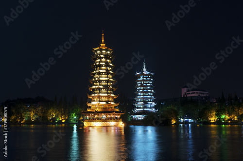 The Sun and Moon Twin Pagodas illuminated at nigh in the city of Guilin, China