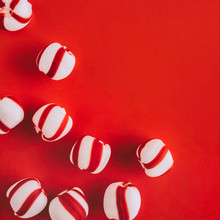 Peppermint Candies On Red Back...
