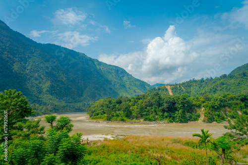Foto op Aluminium Blauwe jeans Beautiful landscape view, with a river and vegetation in the mountains of Pokhara Kathmandu, Nepal