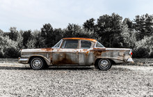 Circa 1957 Old Rusted Vintage Studebaker 2 Door Car On The Side Of A Road In Holden, Maine. Taken July 2017