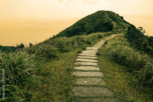Fototapeta Fairy tale landscape and stepping stone path over a hill on the horizon at the Caoling Historic Trail in Taiwan obraz