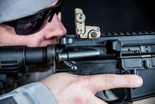 Militia Man Aims Assault Rifle