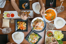 Top View Of People Eating Thai Food Together.