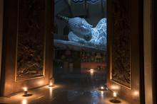 White Buddha Reclining In Buddhist Church At Wat Pha Phu Gon Udonthani Province Thailand.