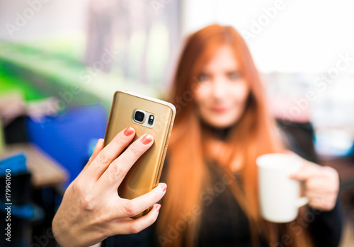 Fototapety, obrazy: Beautiful girl drinking coffee at the coffee shop
