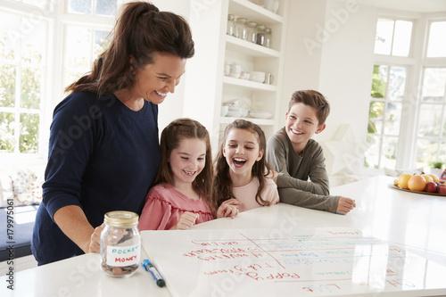 Children Receiving Pocket Money After Completing List Of Chores Wallpaper Mural