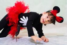 Cute Little Girl In A Bear Cos...