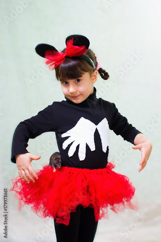 cute little girl in a bear costume with ears holds a hand rat Wallpaper Mural
