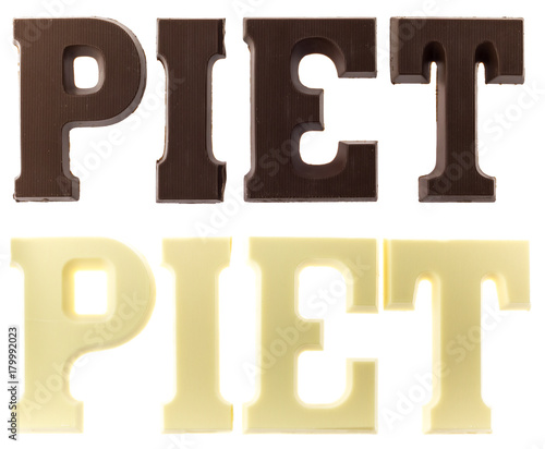 Letters in dark and white chocolate spelling the name of Black Pete Tapéta, Fotótapéta