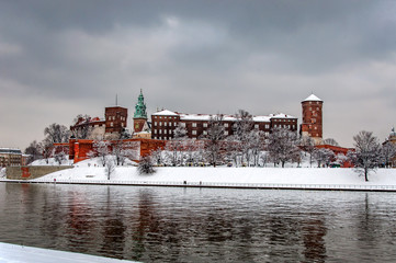 FototapetaHistoric royal Wawel Castle and Cathedral in Cracow, Poland, with Vistula river on a cloudy day in winter.