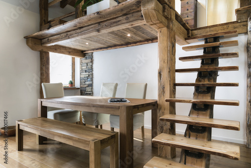 wooden table in dining room under mezzanine © Federico Rostagno