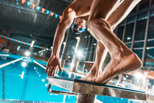 swimmer jumping into pool Fototapeta