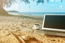 Laptop And A Cup Of Coffee Sea View