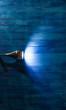 light of a spotlight on a blue wooden wall