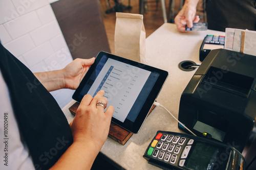 Closeup shot of caucasian cashier hands Canvas Print