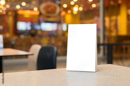 empty brown wooden table and coffee shop interior with mock up menu