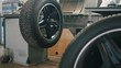 Repairing tires in car service - mechanical workshop
