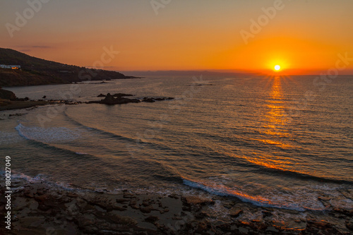 Foto op Canvas Cyprus Beautiful sunset at a rocky beach in Pomos, Cyprus