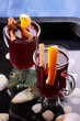 Christmas mulled wine in water, mulled wine with cinnamon and anise, drink with honey, mulled wine glass with seashells in water, retro style, drink with orange slices, pop art style