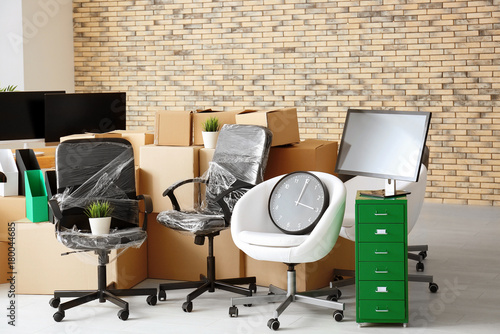 Obraz Carton boxes with stuff in empty room. Office move concept - fototapety do salonu