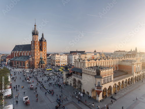 Fototapeta Old city center view in Krakow, aerial drone photography at sunset time, famous cathedral in evening light, the Cloth Hall in Poland obraz