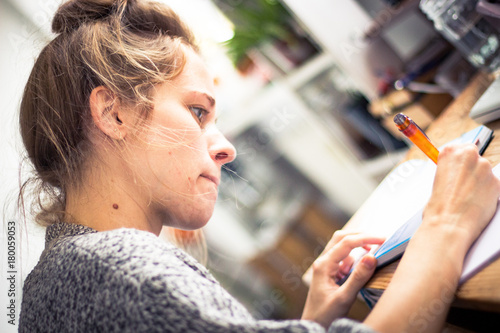 Valokuva young woman studying and handwriting