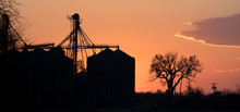 Sunset Behind Silo Complex On ...