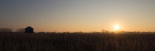 Sunrise Over Frost Covered Cornfield