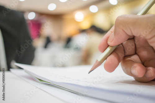 Business people making and writing notes at conference seminar with blur light business peple background Canvas-taulu