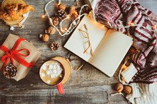 Weekly Planner Or To Do List Top View With Christmas Decorations And Hot Cocoa. Choosing Gifts And Planning Holidays Concept