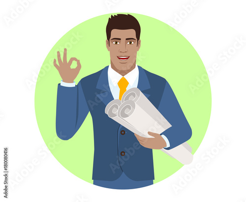 Businessman holding the project plans and showing a okay hand sign Canvas Print