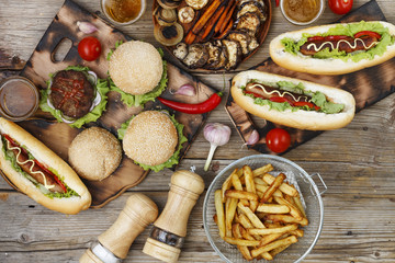Various fast food on a wooden table. top veiw