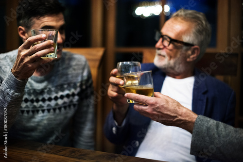 Two friends having a drink together.