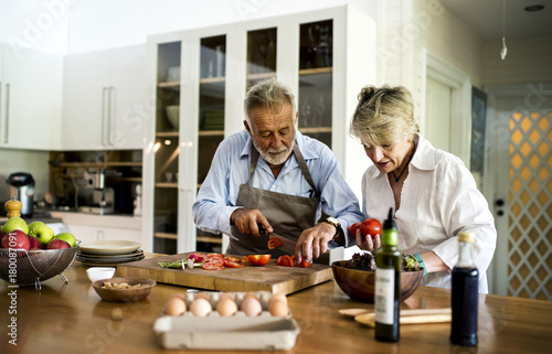 Foto op Plexiglas Koken Couple are cooking in the kitchen together
