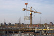 crane carry construction material on new building construction site