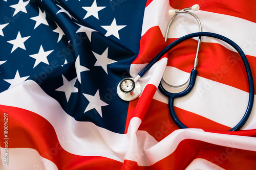Fotografering Close-up Photo Of Stethoscope On American Flag. medicine USA