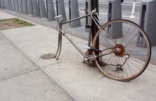 Broken, Rusty Bicycle Locked T...