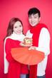 Leinwandbild Motiv couple hold pig and envelope