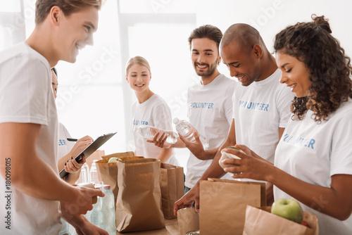 Fotografie, Obraz  multiethnic group of volunteers