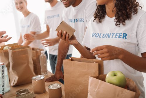 volunteers packing food and drinks for charity Fototapeta