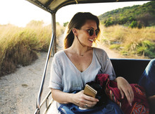 Young Woman On The Road Trip To The Nature