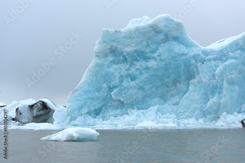Poster Glaciers Blue iceberg in water of Iceland lagoon