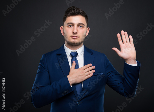 Businessman holds his hand on his chest Wallpaper Mural