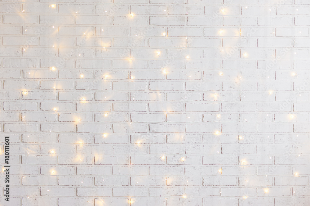 Fototapeta white brick wall background with shiny lights