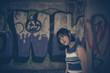 Portrait bohemian girl in the bulding vintage dark tone,lifestyle moden teens
