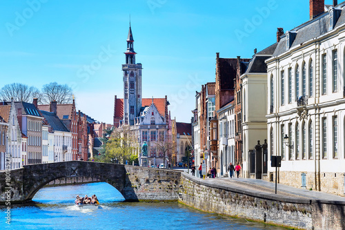 Poster Northern Europe Panorama with canal and colorful traditional houses against blue sky in popular belgian destination, Bruges, Belguim