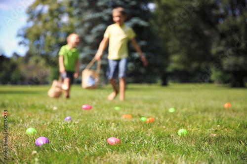 Fotografie, Obraz  happy children at the Easter egg hunt