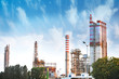 column tower petrochemical plant stand with blue sky background