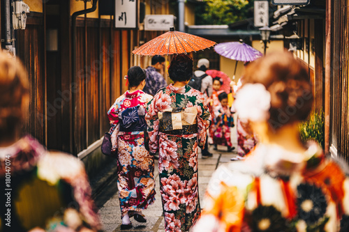 Valokuva  Women in traditional japanese kimonos walking in Kyoto, Japan