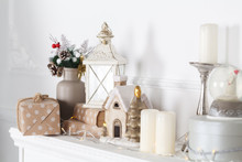 Fireplace Mantle Is Decorated For Christmas With Garland, Lights, A Bow And Other Decorations.